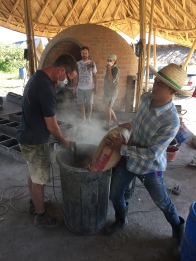 Mark and Noi mixing cement